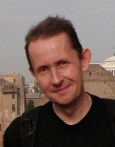 Per Hallén, industrihistoriker och fotograf med kvarnbyn på linsen.