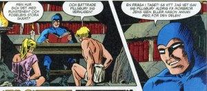 Fantomen läser högt ur Fantomen-krönikan om Kensingtonstenen för sina barn Kit och Heloise.